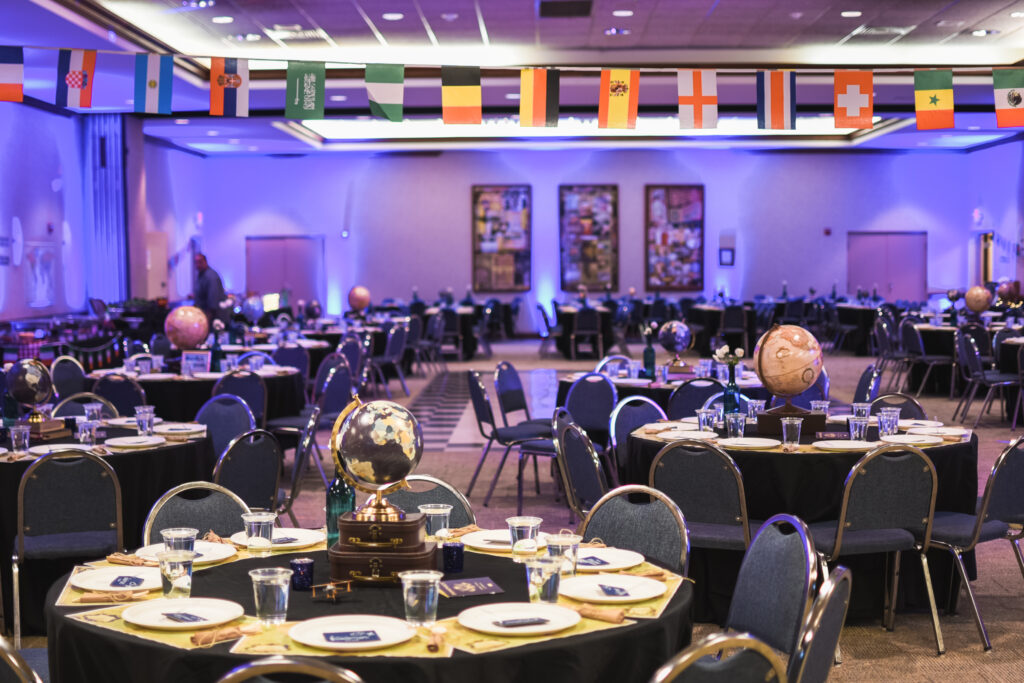Chinese food station and Saturday night reception globe and suitcase  centerpieces with luggage tag party favors travel theme party decor decorations for a travel themed around the world bar mitzvah celebration Brianna K bits of Bri party planner