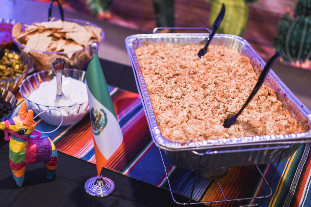 Mexican food station and Saturday night reception globe and suitcase  centerpieces with luggage tag party favors travel theme party decor decorations for a travel themed around the world bar mitzvah celebration Brianna K bits of Bri party planner