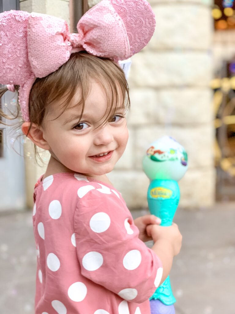 Presley with pink minnie Mouse ears and pink polka dot dress with bubble maker at Disneyland Paris summer 2019 Brianna K bitsofbri disney blog