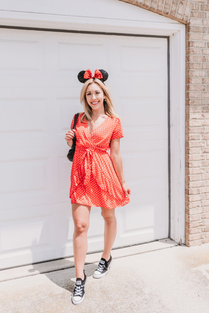 Brianna K bitsofbri in red polka dot dress and minnie mouse ears disney outfit disney blog
