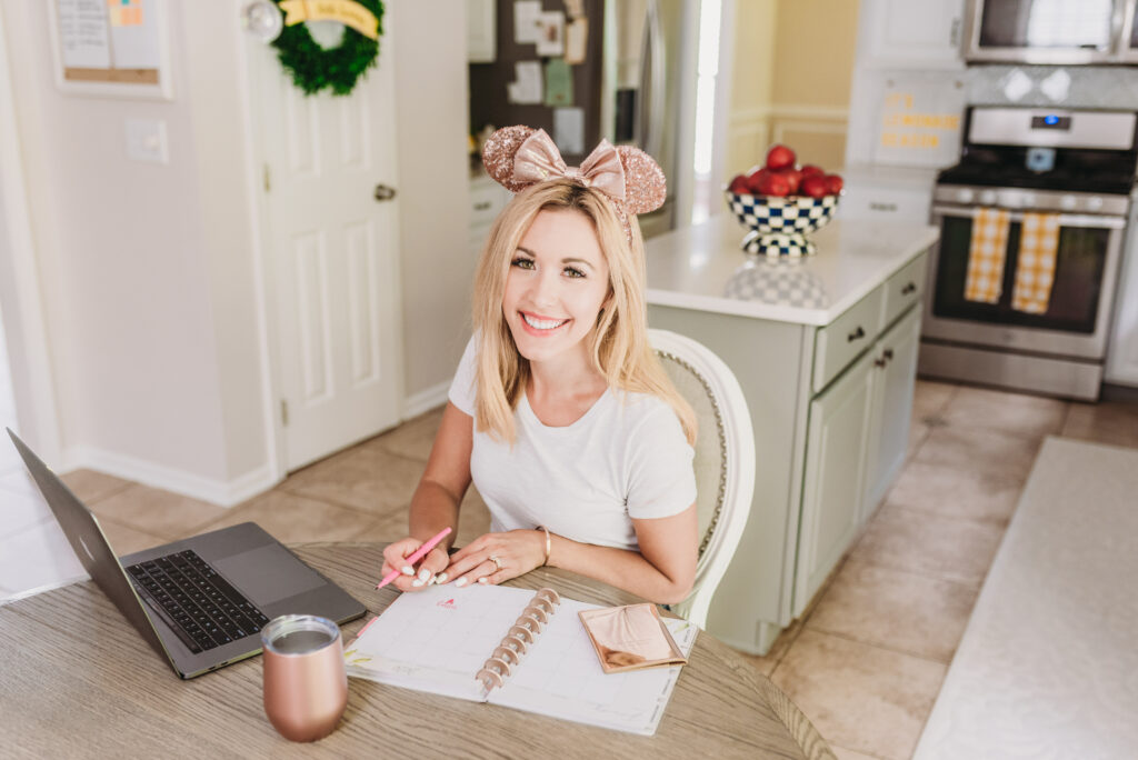 Disney Mom wearing rose gold minnie mouse ears answering frequently asked questions about Disney Vacation planning guide Brianna K bitsofbri wearing rose gold Minnie Mouse ears for Disney Q+A blog