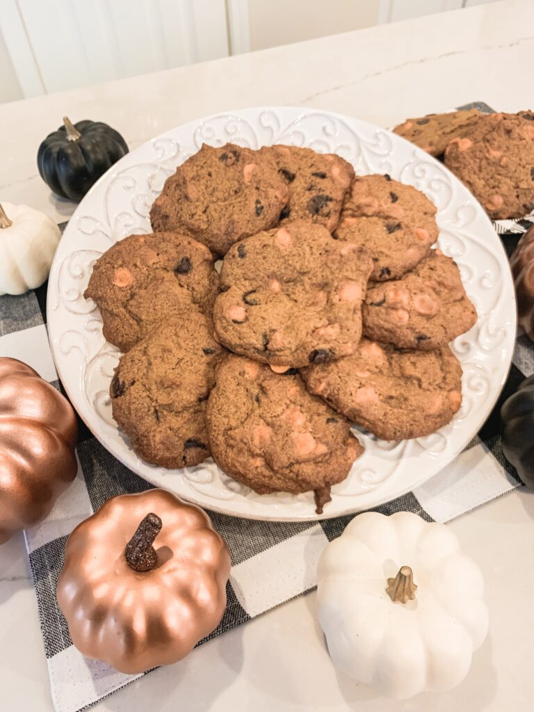 chocolate chip pumpkin cookies on a white platter with rose gold pumpkins and black and white buffalo plaid placemat | Brianna K bits of Bri fall baking recipes blog cooking how to tutorial ingredients directions