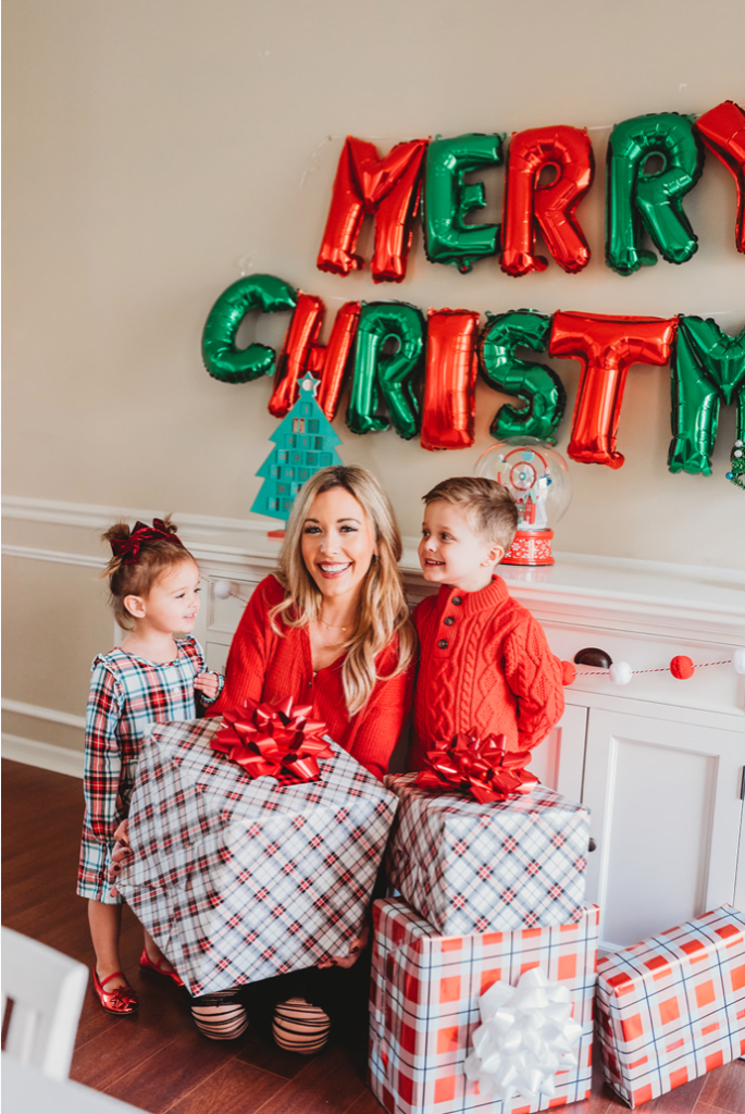 mom and two kids with presents and christmas balloons decorations Brianna K Landon Presley gifts gift guides