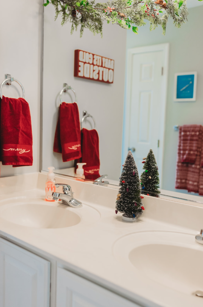 Christmas bathroom decor red merry towels baby it's cold outside sign 2019 Brianna K bitsofbri christmas clean and decorate with me