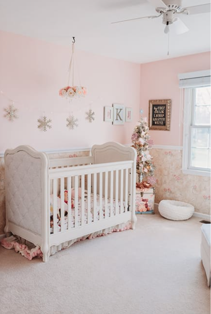 baby girl christmas bedroom decor pink and gold and rose gold decorations for christmas nutcracker ballet theme bedroom white tufted crib and gold snowflakes and champagne tree Brianna K bitsofbri Presley daughter christmas bedroom